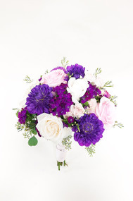 Classic round bouquet in non classic colors.  With beautiful blush roses and bright fuchsia accents of dianthus,  dahlias and asters is a fun summer twist on a classic.