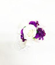 Beautiful and simple fresh flower wrist corsage on a keepsake bracelet