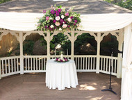 Stunning spray or beautiful blush roses and fuchsia accents of roses, dahlias with pink larkspur are a great backdrop for your ceremony.