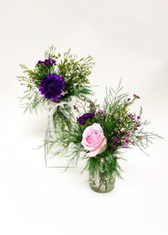 Beautiful Isle way mas on jars and centerpieces. Designed with love at your Loveland Florist
