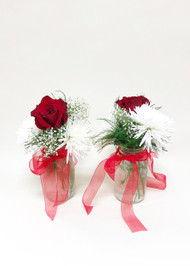 Simple red and white mason jar to be used for aisle decoration and reception centerpieces.
