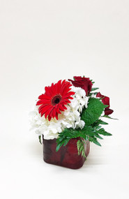 Red cubes filled with white hydrangea, red gerberas, roses and green are great for a bold table.