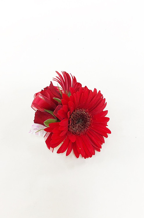 The bold red corsage to coordinate with your bold red bouquet!