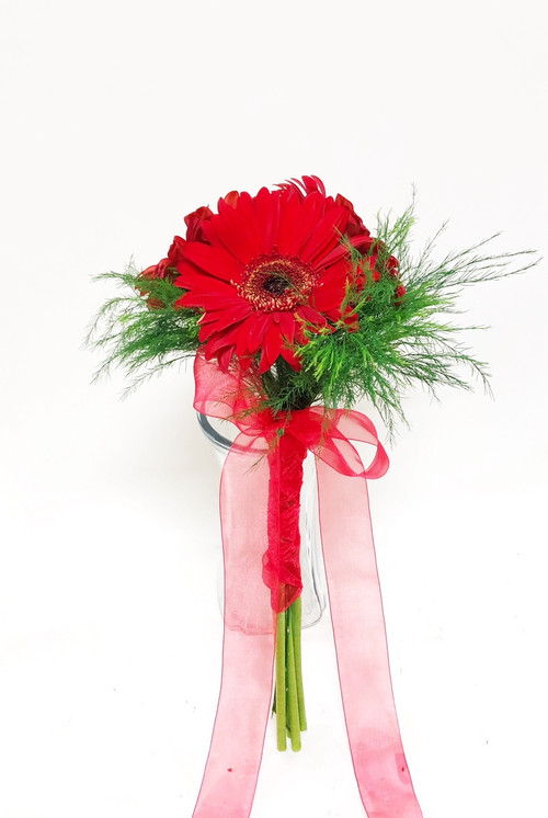 All red  Bridesmaid Bouquet designed with Gerbera Daisies.  This wedding design  brought to you custom designed by Earle's Loveland!