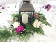 Add class to any lantern design with beautiful fresh flowers in a wreath design