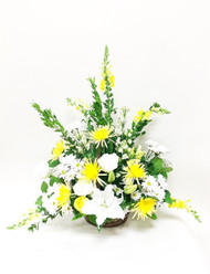 A bright mix of yellow and white fresh flowers designed in a one sided fan shape perfect for the service. Flowers include mums, roses, lilies and other accent flowers.