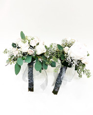 Ivory garden roses surrounded by ivory spray roses, baby's breath and eucalyptus are just the answer for your bridesmaid bouquets.