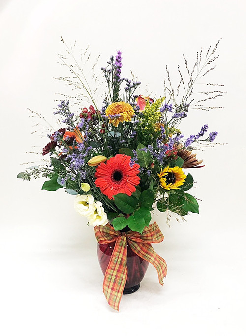 A Beautiful fall mix arranged with Gerbera daisies, local grown sunflowers, and bursts of fall colors. This variety of fresh flowers has fall blooming from it.