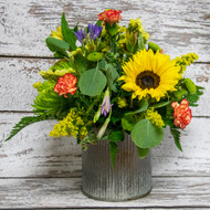 Stunning fall arrangement with bright and bold colors in a tin container