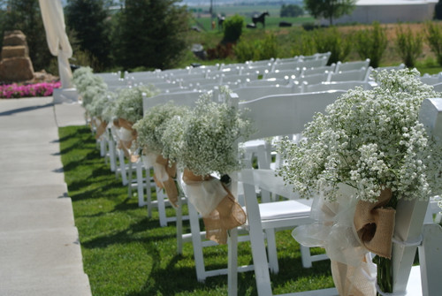 Baby's breath bundles with burlap bows, make for the perfect accent for your aisle decorations.