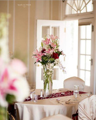 Elegance in pink white red and ivory! This Centerpiece is pure beauty with local grown lilies!