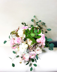 Beautiful soft pink garden roses, succulents and eucalyptus make this bouquet elegant and fun for a summer wedding!