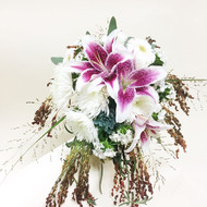 Beautiful and incredibly unique this lily bouquet features stargazers, spider mums and mixed grasses!