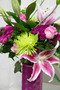 Get a few of all the favorites in this arrangement. With hot pinks and bright green colors, this fresh flower arrangement is a bold one! Locally grown Stargazer lilies, beautiful pink roses, mixed filler, accented with some bright green mums! Definitely something fancy for someone special!