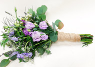 A bit of the wild flower fell in this mixed purple bouquet. Add some wedding chic with the burlap wrap.