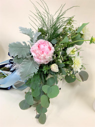 Pink Peony, eucalyptus, and mixed greens bridal bouquet.