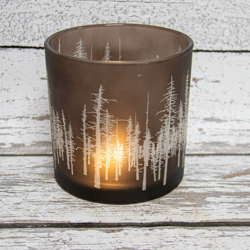 Beautiful lit hurricane glass with the tree line view!