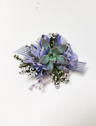 Succulent corsage with wlavender flowers, ribbon and sparkle