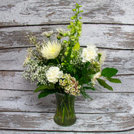 All white fresh flowers in a clear vase. This beautiful  mix is a great choice for sympathy.