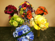 How fun for everyone to carry flowers in their favorite colors and the bride to carry all the colors in her bouquet!
