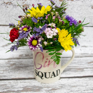 "A perfect mug for that lady that is in your ""Girl Squad""! An empowering mug with a mixture of fresh, bright, and seasonal flowers that will make your friend think of you everytime they use it! Back of the mug reads : ""Behind every successful woman is a tribe of other successful women who have her back!"""