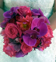 Like a bit of wow?  Here in fuchsias and hot purples in a  wonderful bold choice of orchids, dahlias, and roses.