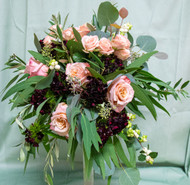 This gorgeous bouquet is designed with pink roses, peonys and set with greenery.