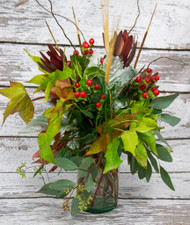 This arrangement full of fall foliage will add a taste of autumn to your home.