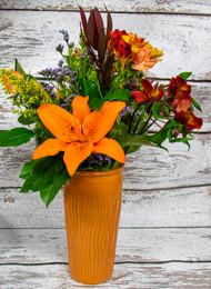 This beautiful arrangement includes vibrant autumn colors that include;