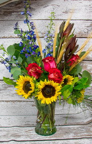 This stunning arrangement in a clear vase will add sunshine to your home with a touch of fall.  We offer DAILY deliveries to the Medical Center of the Rockies, Northern Colorado Rehab Center, McKee Hospital, Poudre Valley Hospital, Banner Fort Collins and other local facilities.