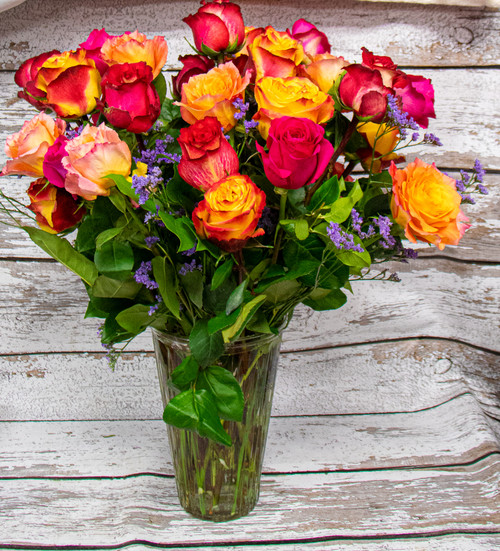 Beautiful and vivid autumn inspired roses in a stunningly large arrangement.
