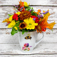 Beautiful Dean Crouser watercolor Bee mug with a vivid arrangement of autumn flowers!