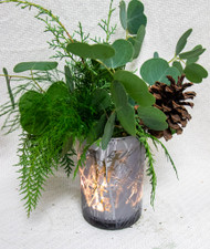 Enjoy seasonal greens and pinecones in a festive holiday vase!