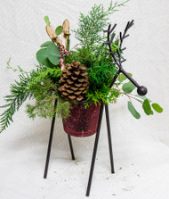 This unique reindeer container featuring winter greens and pinecones will certainly be a conversation starter this holiday season!