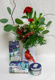 Beautiful Cardinal watercolor vase with winter greenery and bright flowers. With Michel Designs holiday candle soap and body lotion!