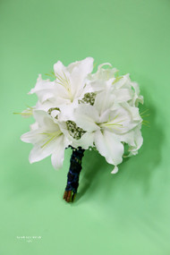 How about just a simple bouquet of locally grown white oriental lilies and baby's breathe accent, just simple and beautiful.