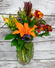 This beautiful arrangement in a clear vase includes; lilies, alstoemeria, roses and more!