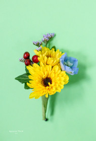 Perfect late summer boutonniere of viking poms, delphinium floret and hypericum berries.