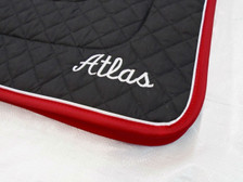 "Wilker's Dressage ""Winning Colors"" Black with Red Trim and White Piping with Embroidered Text Close Up"