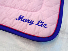 Pink Embroidered Saddle Pad with Purple Trim and Raspberry Piping Close Up