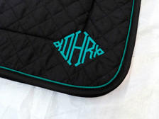 Black Embroidered Saddle Pad with Black Trim and Teal Piping Close Up