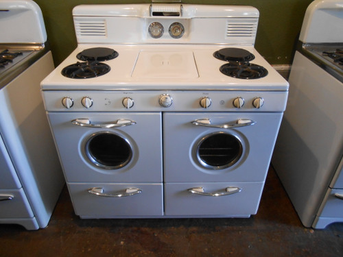 WESTERN HOLLY 42 INCH VINTAGE PROPANE GAS RANGE 4 BURNER WITH CENTER GRIDDLE LEFT SIDE BROILER OVEN RIGHT SIDE OVEN BROILER DRAWER PORT HOLE OVEN DOOR WINDOWS WHITE LOCATED IN OUR PORTLAND OREGON APPLIANCE STORE