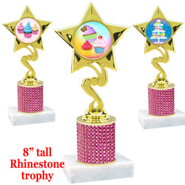 "Cupcake theme trophy with pink rhinestone column.  Choice of cupcake insert artwork.   8"" tall - 80106"