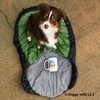 Aspen loves to cuddle with his Alcott dog sleeping bag