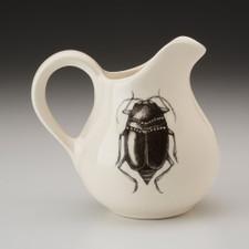 Creamer: Black Beetle