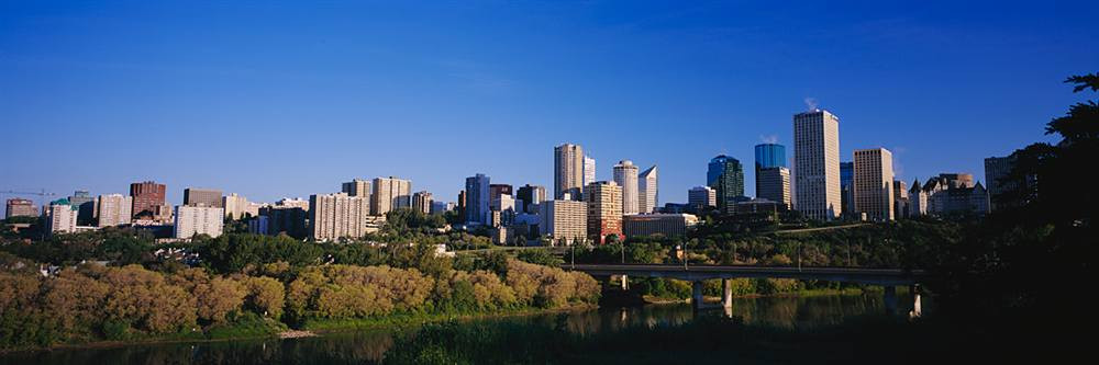 Edmonton Skyline In Front Of A River