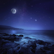 Rocks Seaside Against Rising Moon And Starry Field Crete Greece