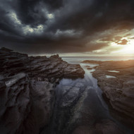 Huge Rocks On The Shore Of A Sea With Stormy Clouds In Sardinia Italy
