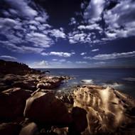 Huge Rocks On The Shore Of A Sea Against Cloudy Sky Sardinia Italy