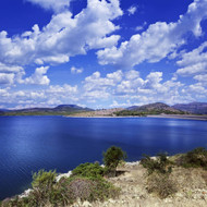 Tranquil Lake Against Cloudy Sky Sardinia Italy